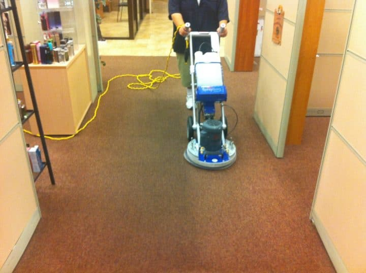 Carpet Cleaning by employee from optimal prime cleaning services