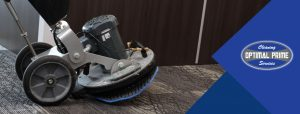 Commercial carpet cleaning machine cleaning carpet