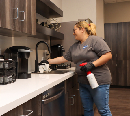 office cleaner disinfecting kitchen counters
