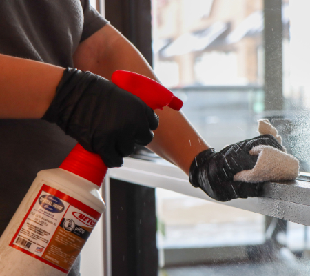 close up of commercial cleaner disinfecting surfaces for coronavirus