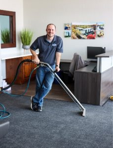 smiling office carpet cleaning staff